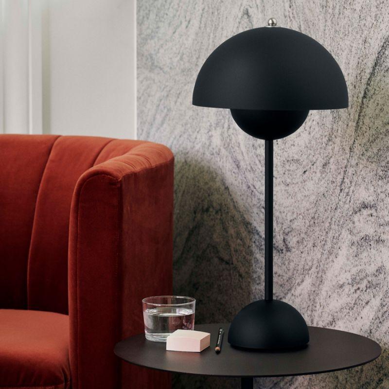 Flowerpot VP3 Matte Black on coffee table